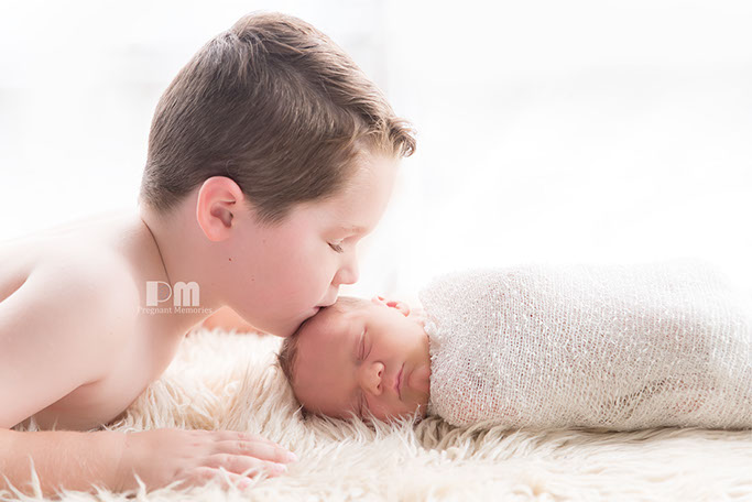 Pregnant memories sibling with newborn photos photographer gold coast